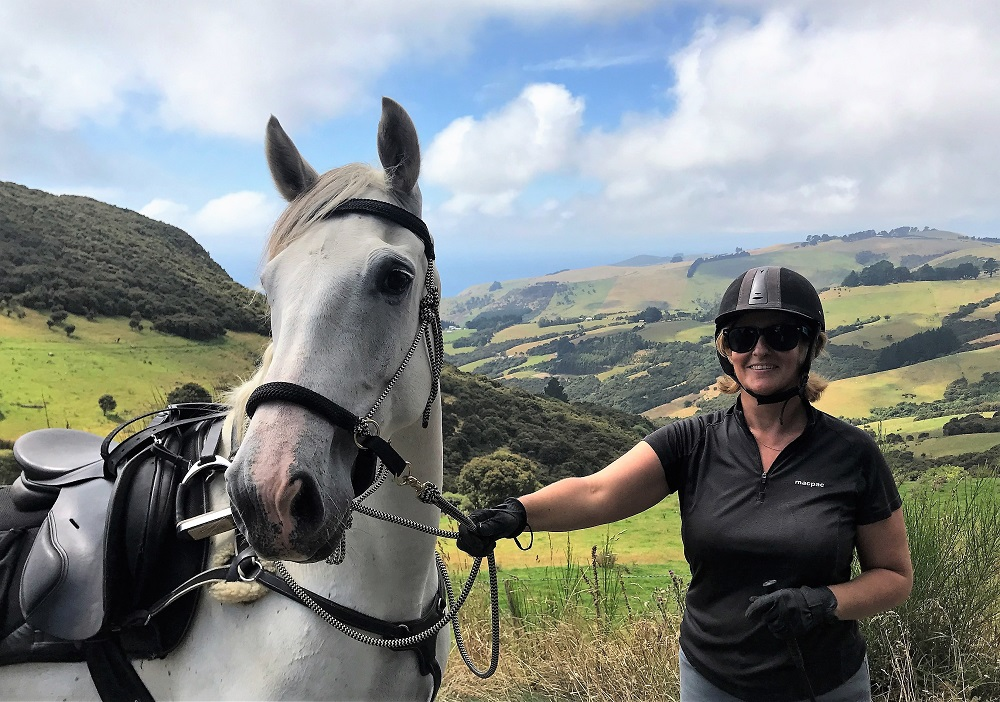 Hallie and Blue wearing the LightRider Natural Rope Bridle.