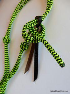 Tie around the latigo.